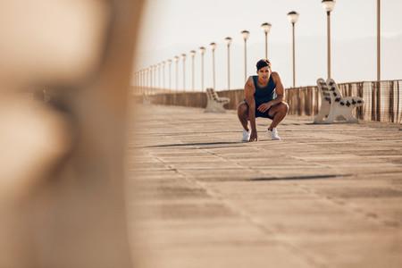 Healthy man taking a break after morning run