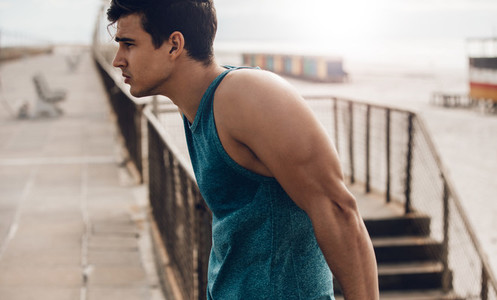 Fit young man standing outdoors