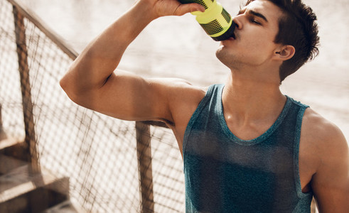 Man drinking water after running workout