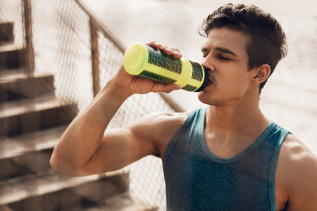 Runner drinking water after exercising