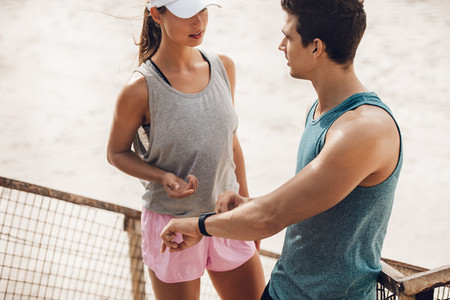 Young couple discussing training performance in break