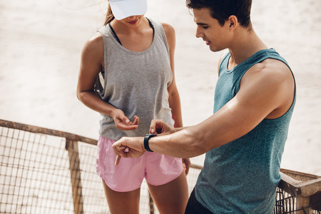 Couple using wearable technology during workout