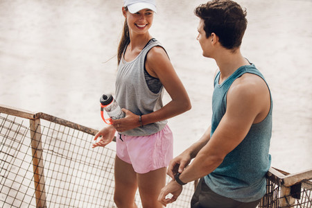 Young couple resting after running workout