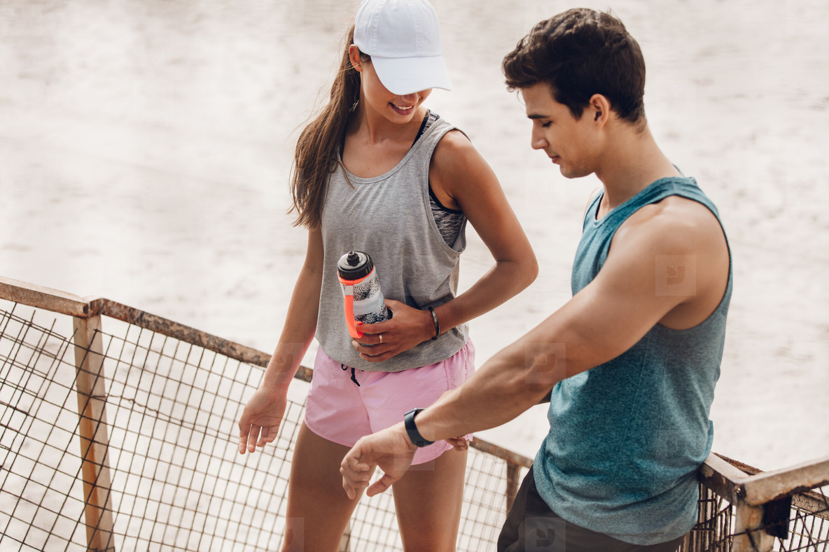Couple checking performance on fitness device