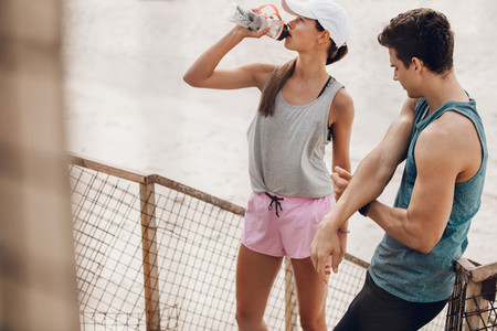 Young couple taking break after exercising