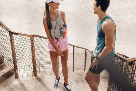 Couple relaxing and talking during workout break