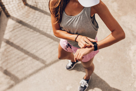 Runner using smart watch to monitor her progress
