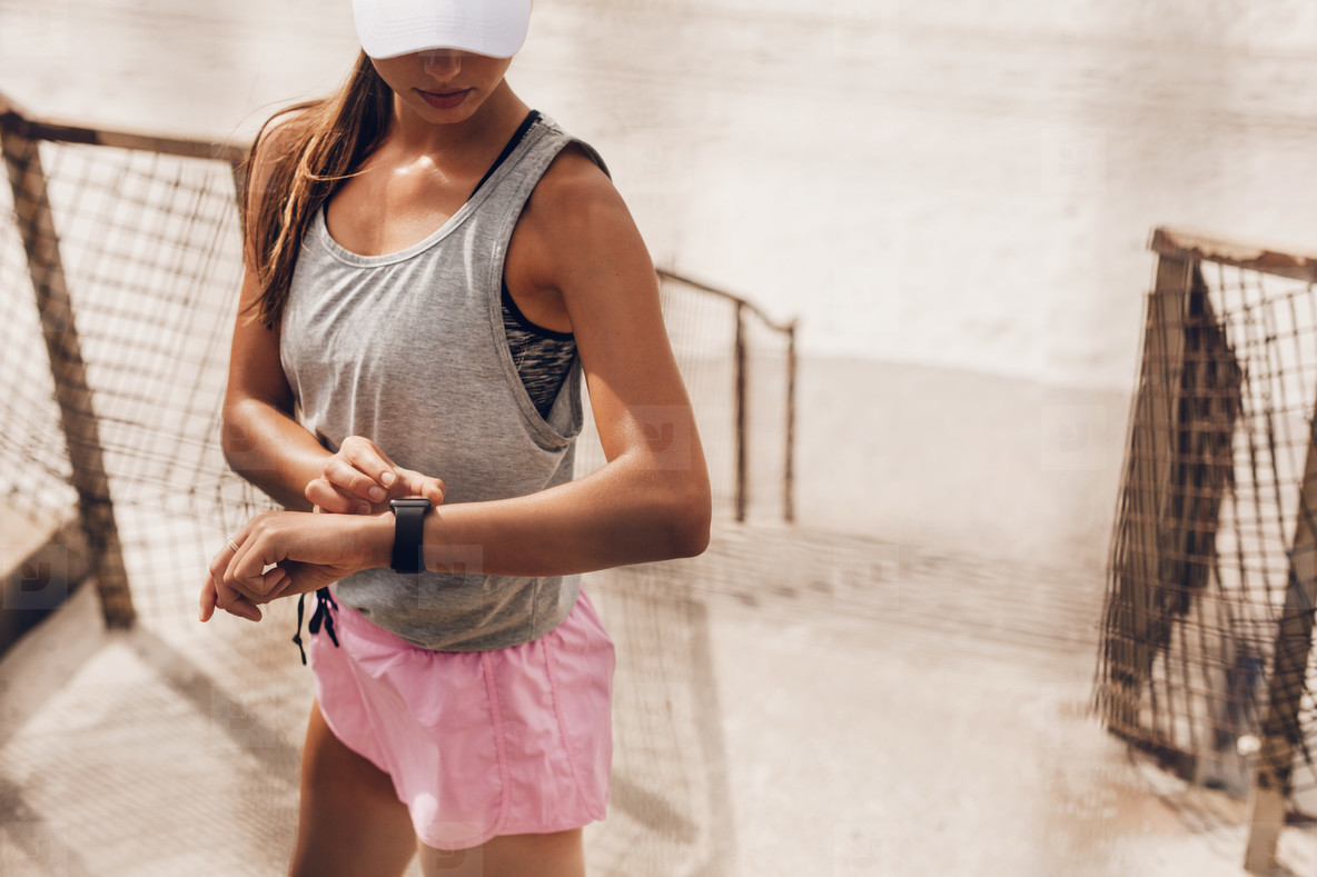 Woman setting their fitness app before workout