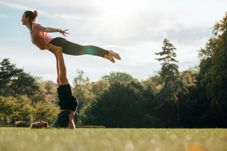 Fit young couple practising acroyoga