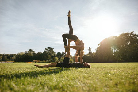 Healthy young couple doing acroyoga