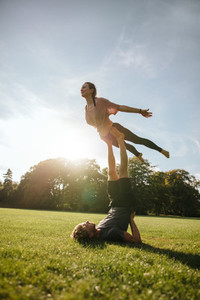 Fit young couple doing acrobatic yoga