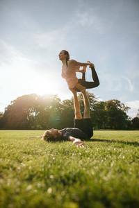 Couple doing acroyoga workout