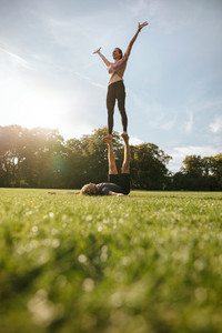 Couple doing acroyoga exercise in park