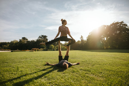 Acro yoga workout on grass