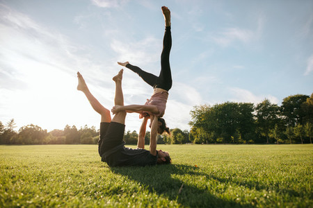 Flexible couple doing acrobatic workout