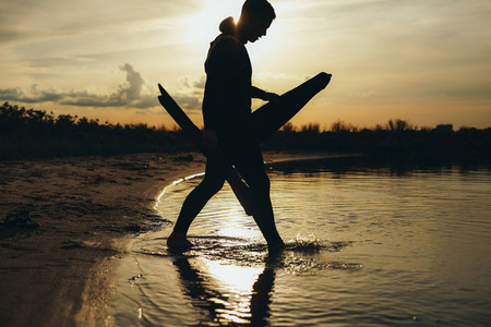 Young man going for spearfishing at evening