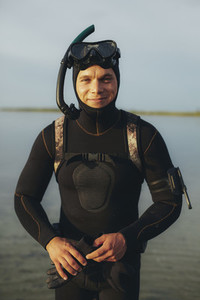 Young guy ready for snorkeling in sea