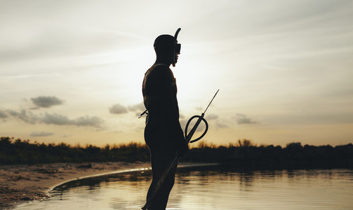 Male diver with speargun ready for underwater fishing