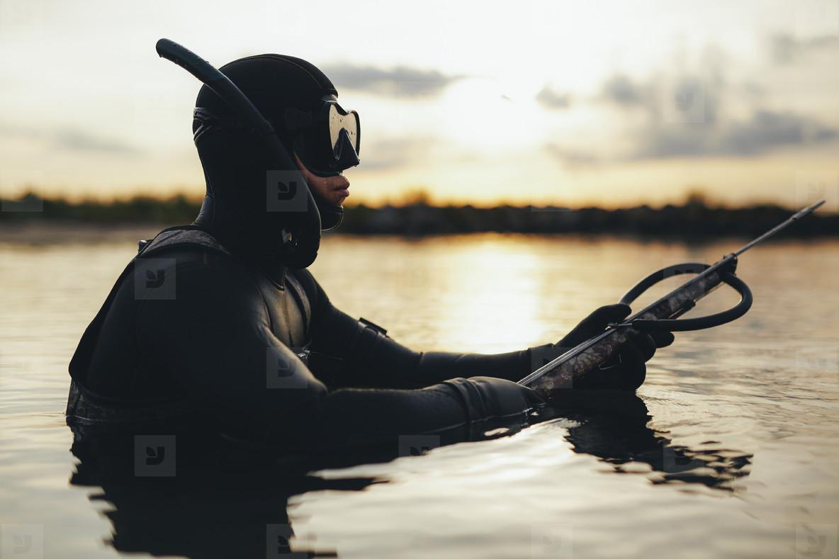 Underwater fisherman in sea