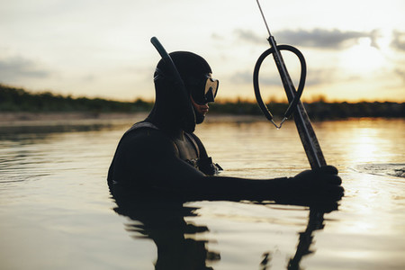 Underwater fisherman fishing with speargun