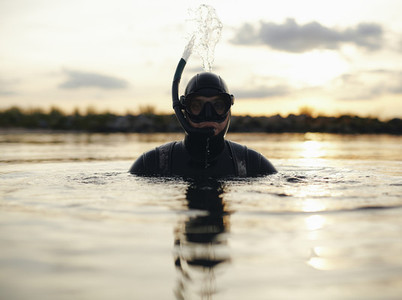 Young adult snorkeling in sea