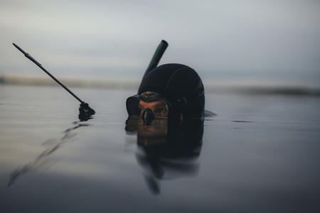 Spearfishing diver looking for an opportunity to hunt
