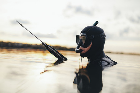 Diver a gun for underwater hunting in a water