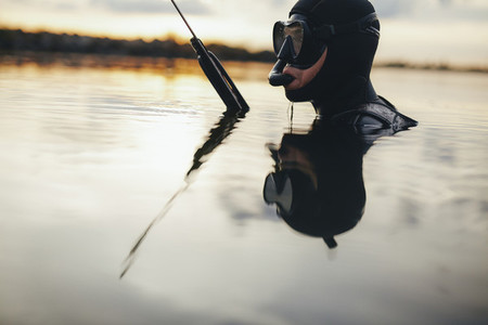 Spearfishing diver submerged in water