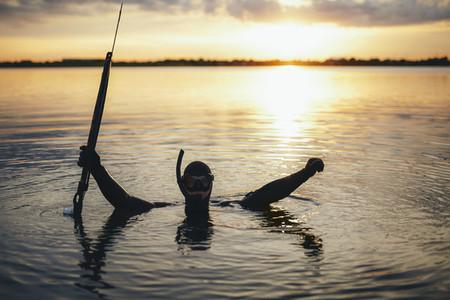 Enjoying spearfishing in evening