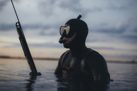 Male spearfishing diver with speargun