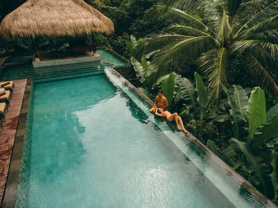Couple relaxing at the poolside of resort