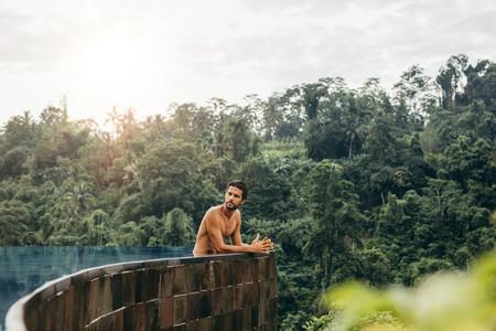 Caucasian man relaxing in swimming pool