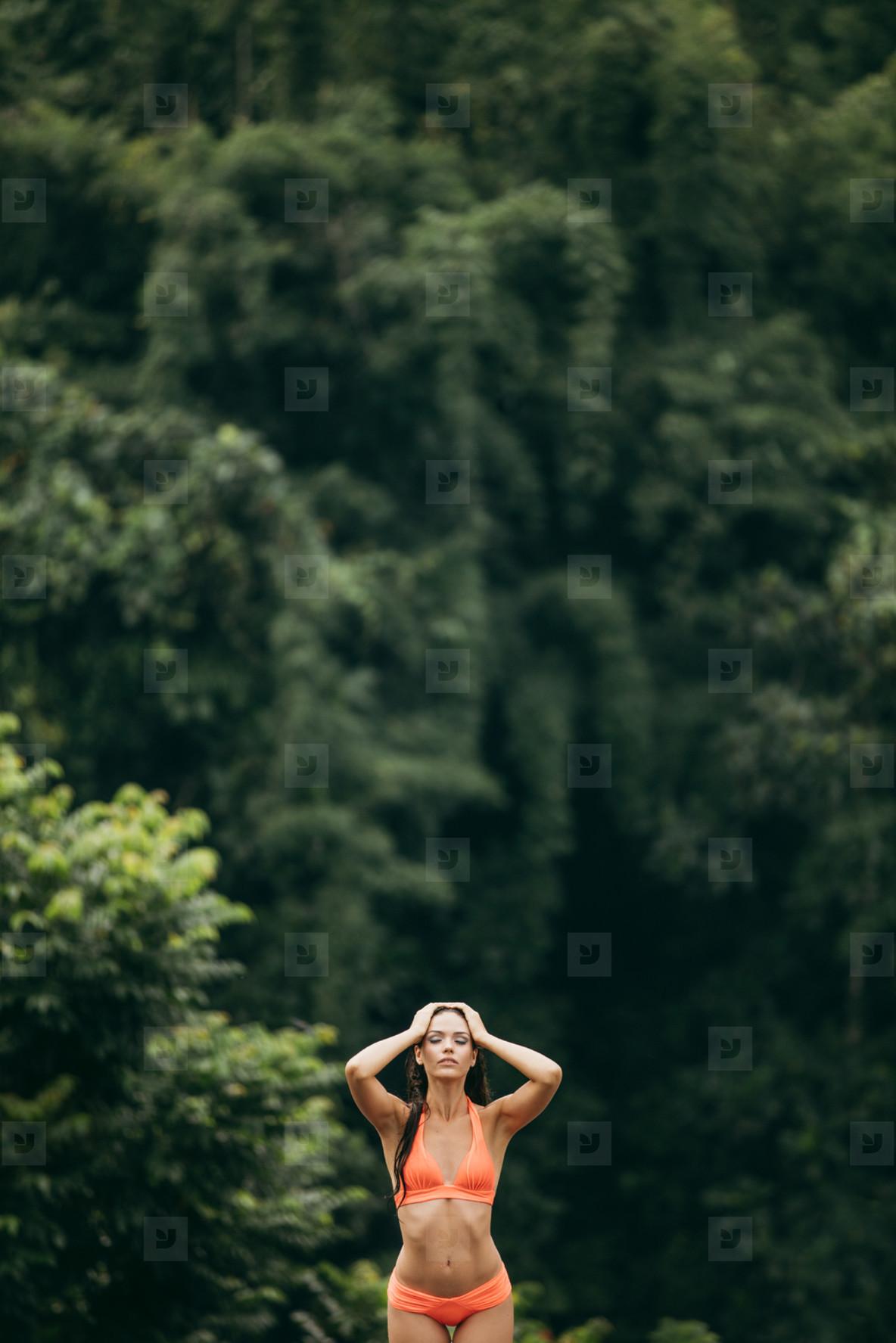 Beautiful young woman posing in bikini