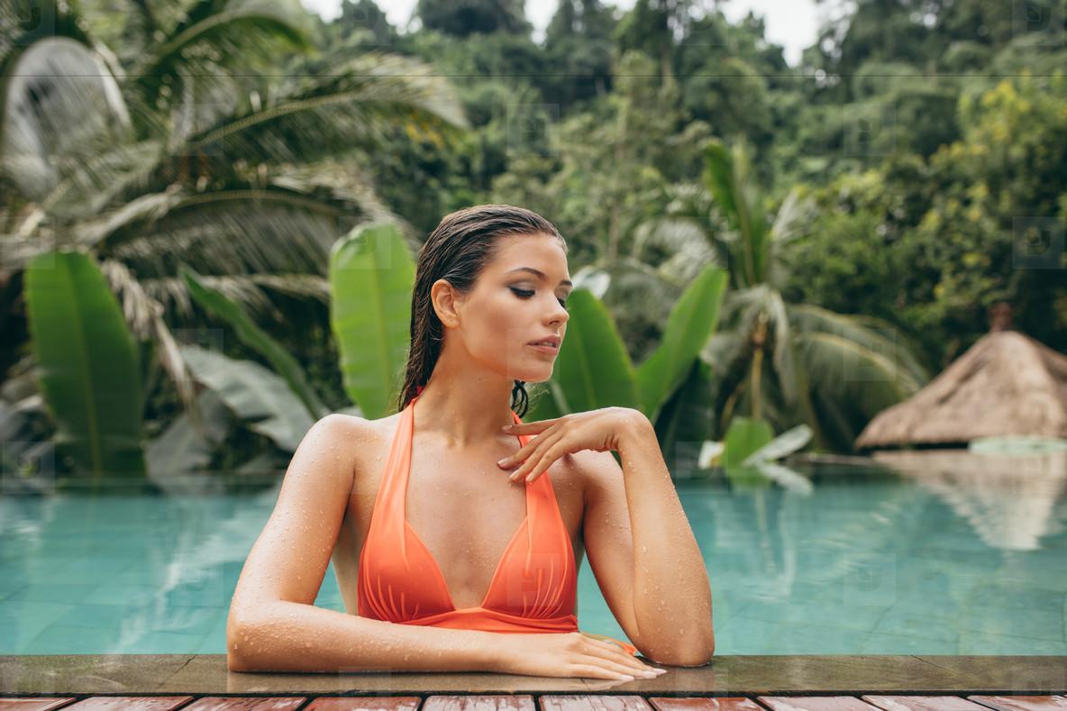 Sensual young woman in swimming pool