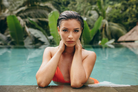Attractive young woman relaxing in swimming pool