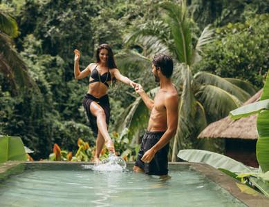 Loving couple having fun in swimming pool