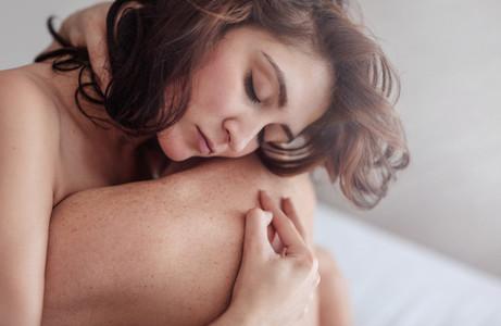 Couple making love in bedroom