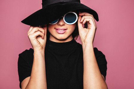 Female model with hat and stylish sunglasses