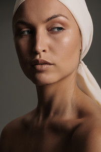 Female model with natural makeup and head scarf