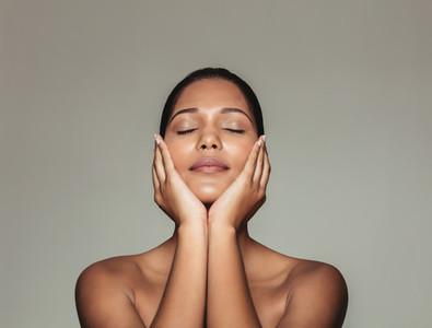 Beautiful woman touching her fresh clean face