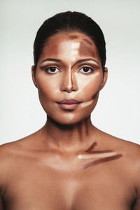 Young woman with contour and highlight makeup on face