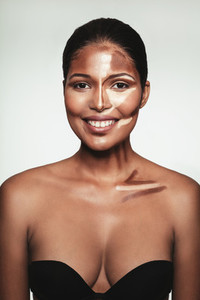 Happy woman with contour and highlight makeup