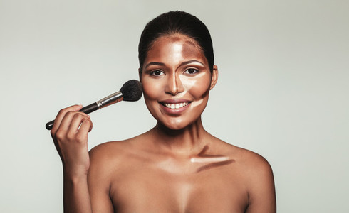 Contour and highlight makeup on female model face