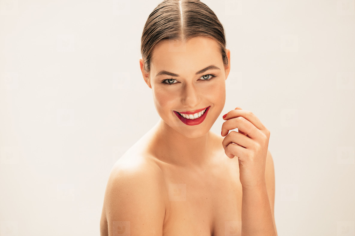 Beautiful young topless woman smiling
