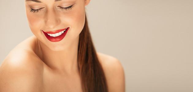 Shirtless young woman with makeup