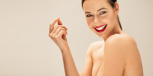 Smiling young woman with perfect skin