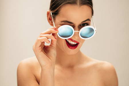 Beautiful woman winking with glasses