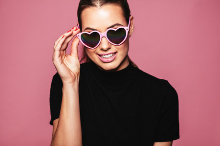 Young woman posing with glasses