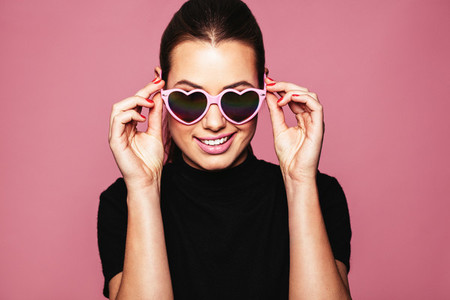 Stylish young woman posing with funky shades