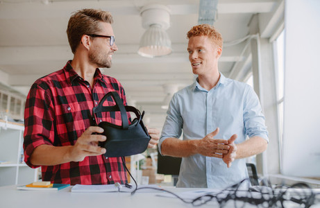 Young developers discussing on new virtual reality glasses